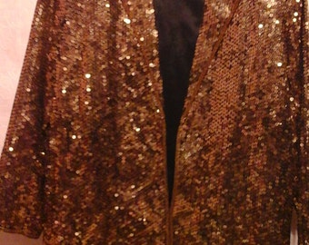 Vintage 1980s blazer. Fully sequined gold. Jazz up anything, everything in this rocking 80s jacket.