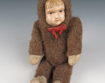 Celluloid faced boy in teddy bear body