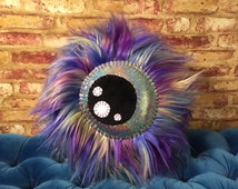 Borealis Beast Furry Monster Eyeball Pillow With A Sparkle Rainbow Galaxy Eye, Round Throw Pillow