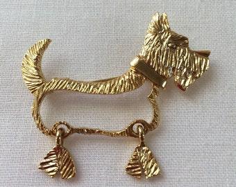 KK/ED figural terrier dog brooch, figural dog brooch