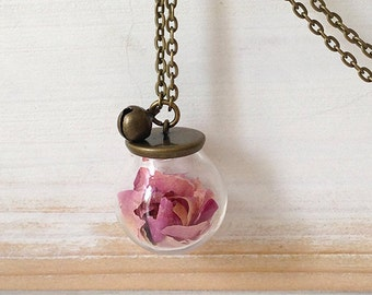 Silver necklace with glass sphere and dried rose