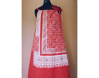 crisp red and white cotton loose fitting summer dress with large pocket , fit small to medium.
