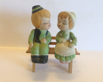 Kissing Boy and Girl on Bench Salt and Pepper Shakers