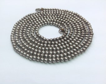 Vintage, Art Deco flapper necklace of silver metal beads, 54 inches, 138 cm long.