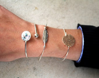 Bangle is 925 sterling silver or gold - plated feather, rhinestones or rosette