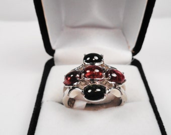 Natural Tourmaline Cabs in a Silver Comfort Back Ring.