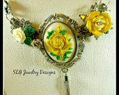 Yellow Roses are the theme of this Statement Piece set within a Pewter Cameo Mount with a Vintage Silver-plated Chain and a tiny tassel