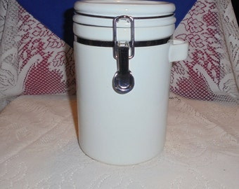 White and Silver Ceramic Cannister