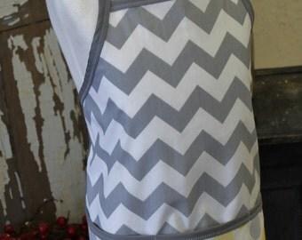 Gray chevron stripes with yellow polka dots