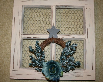 Distressed paneless window with chickenwire