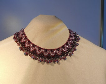 red, black and silver princess necklace. Made of seed beads and crystals with a lobster clasp. 47 cm in length