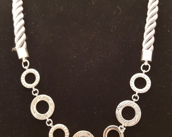 Shimmering cord and metal necklace