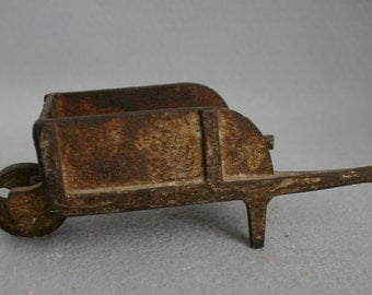 Rusty Cast Iron Toy Wheelbarrow