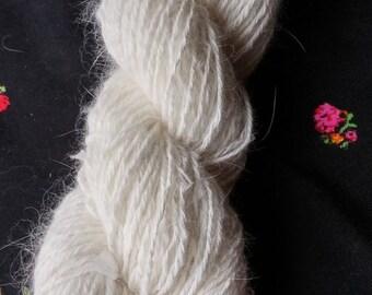 Shashachandra:  100% Angora Yarn, natural undyed white, handspun,4-ply, 200 yards, 3.75 oz