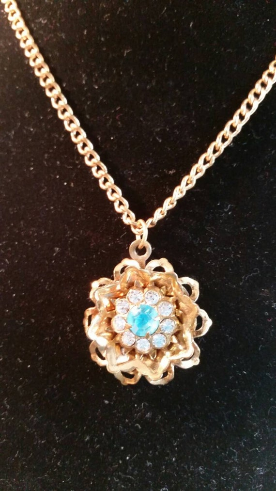 Vintage 1960's Gold tone flower design necklace with Center blue rhinestone surrounded  by 8 clear rhinestones.