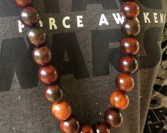 Chunky extra long and extra large 20mm wood round beads for men/women. Great for African, Hip hop or casual wear. Great for any occassion.