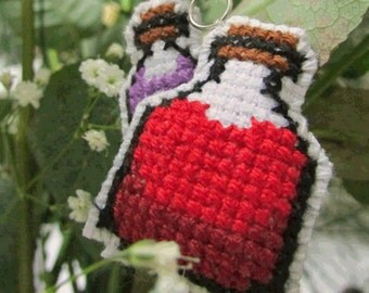 Cute cross stitched red and purple potion bottle keychain, purse/zipper charm