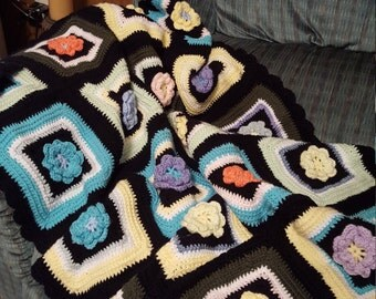 multicolored flowered granny square afghan