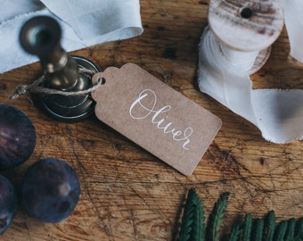 Kraft luggage tags featuring  modern calligraphy hand lettered personalisation