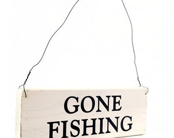 """Wood Sign Saying """"Gone Fishing""""  White Wood Sign With Saying in Black Lettering. 7"""" x 2.5"""""""