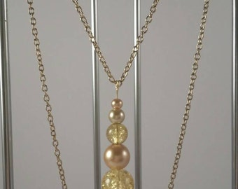 "Pearl dropped - First Collection by SilverJaneSundries 30"" gold plated necklace"
