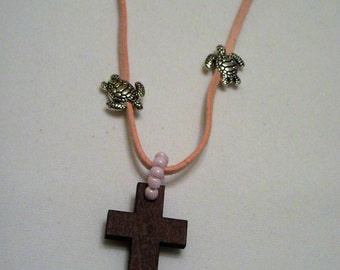 Natural, woood, glass beads, cross. Faux leather.