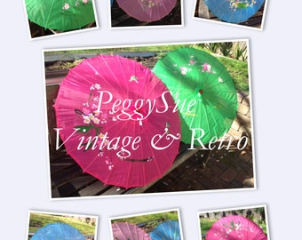 Colourful hand painted bamboo parasols