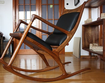 Walnut rocking chair posted with leather