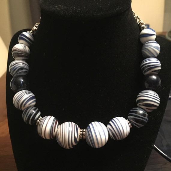 Hand blown venetian style glass beads in white and blue aventurine