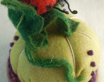 This is a wool felted lady bug sawdust  weighted and ready for your pins and needles you want to find when you need them.