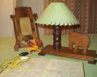 a charming small flashlight, small elephant, deco child