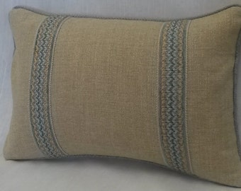 Tan Pillow with Decorative Tape and Welt