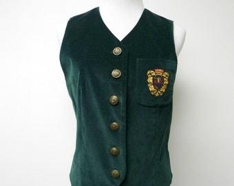 "green velvet . embroidered crest on breast pocket . cotton vest . small / 35"" bust"