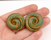 Pair of Handmade Artisan Polymer Clay Ammonite Beads in Gold, Green and Coral Striped Spirals