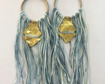 Large hoop earrings with textured brass and hand dyed linen tassels