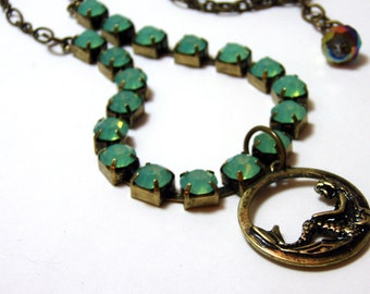 Little Mermaid Necklace - Antique gold metal charm with bright aqua rhinestone accents