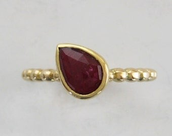 Pear cut ruby stacking ring | Rosecut pear ruby on recycled 14k gold bump band | Alternative engagement ring