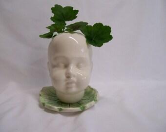 Ceramic Doll Head  Planter on Leaf