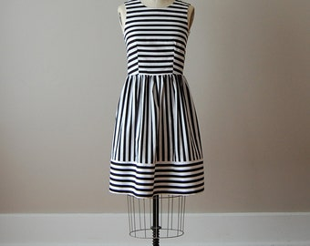 Striped Cotton Dress with Darted Sleeveless Bodice with Gathered Waist and Horizontal Hem in Black and White