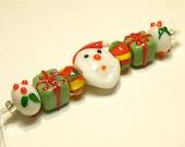 DESTASH -- Seven Coordinating Christmas Lampwork Beads: Santa Claus, Gifts, Holly - Lot UU