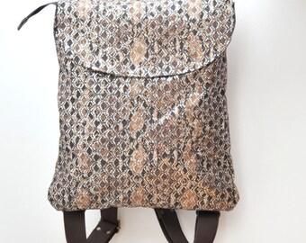 Large vegan rucksack/laptop case with silver metallic snakeskin print, Brown and cream cotton drill backpack, Cotton snake print fabric bag