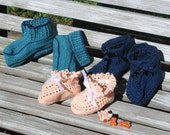 Classic navy baby booties, soft peach mary jane booties, and teal modern booties are handmade from soft cotton