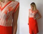 70s midi dress. knit dress. tangerine dress with flower appliqué. made in Italy - medium