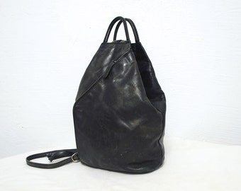 90s black leather backpack. distressed leather rucksack