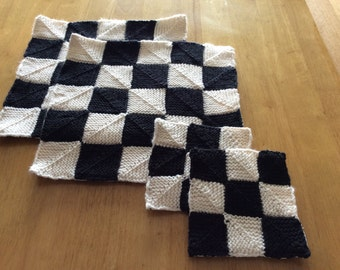 black and white table mats and coasters,lined table mats,lined coasters,black and white mats,handknitted mats,monochrome mats