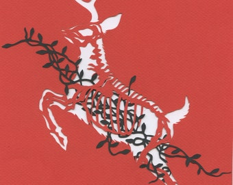 What Rudolph Ate for Christmas paper cut