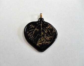 Aspen leaf pendant on black fused glass