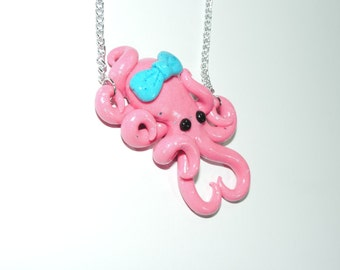 glow in the dark, pink octopus necklace with blue bow,  semi translucent, opalescent, sparkly, glitter, specks, spots, pastel