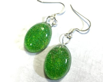 Green seed bead and resin oval earrings