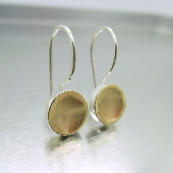 Round dangle silver earrings with brushed gold